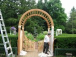 Here we are, hard at work building a glorious garden gate and pergola at a Milwaukee metro home.